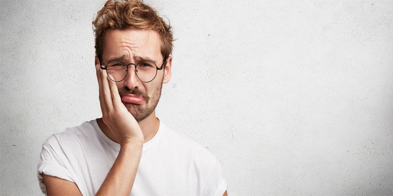 درد-بعداز-کشیدن-دندان-ناشی-از-چیست؟